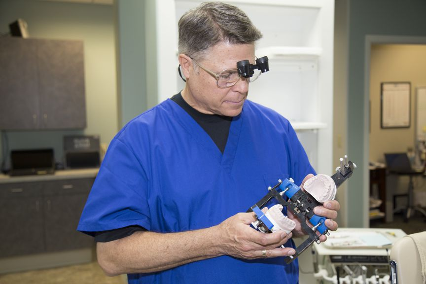 Steven Maurstad, Omaha Dentist looking at dental device